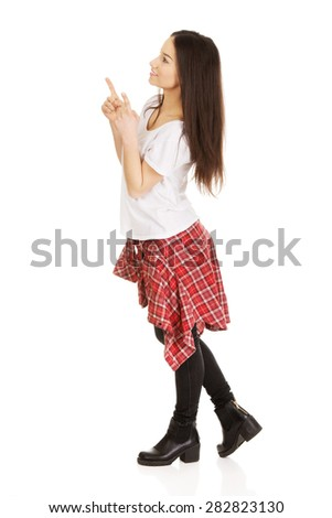 Young student rock woman pointing up. - stock photo