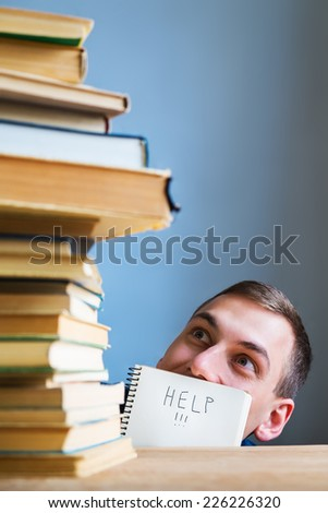 Young Student Stressed and Overwhelmed asking for Help - stock photo