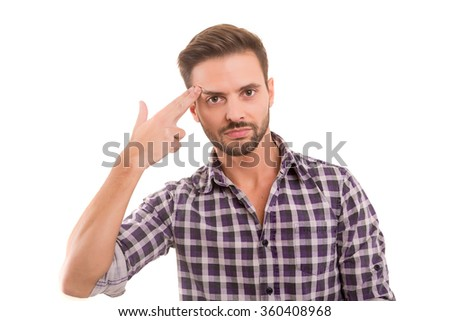 Young student tired of studying for the final exams, isolated over a white background - stock photo