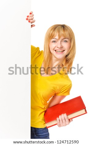 Young student with book standing behind white board. Isolated on white background