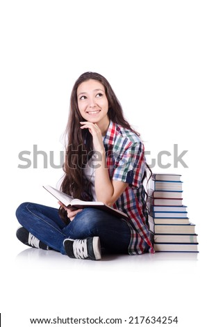 Young student with books isolated on the white