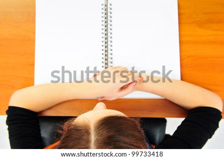 Young student woman doing exercises. Top view - stock photo