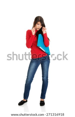 Young student woman holding blue folder. - stock photo