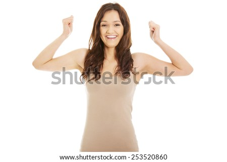 Young student woman making fists in a winner gesture. - stock photo