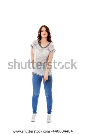 Young student woman pointing down - stock photo