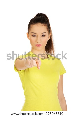 Young student woman pointing on you. - stock photo
