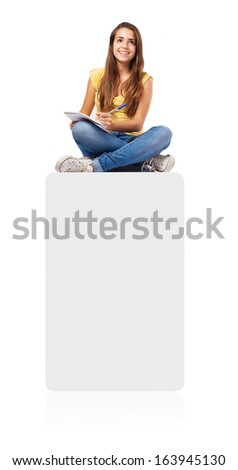 young student woman sitting on a box and studying