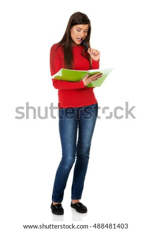 Young student woman with her note.