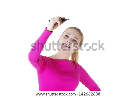 Young student woman writing something on abstract screen with  marker - stock photo