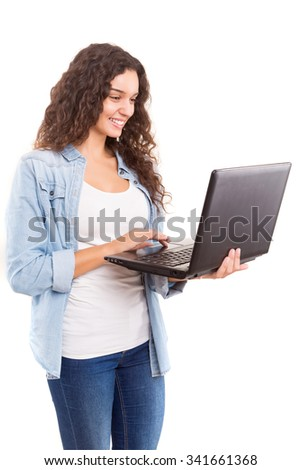 Young student working with her laptop, isolated over a white background