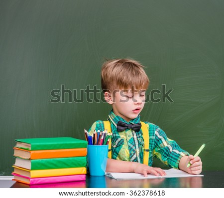 Young student writes in a notebook - stock photo