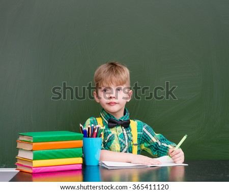 Young student writes in a notebook