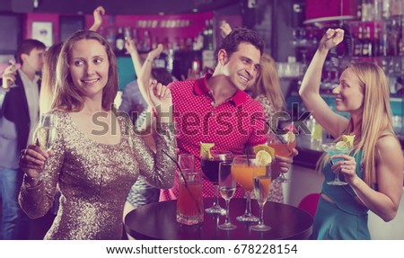 Young students dancing on party with a cocktails in the club