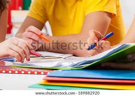 Young students during doing their homework, horizontal - stock photo