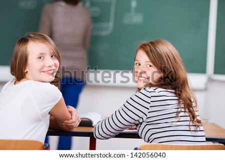 Young students sitting on chair during the class in schoolroom