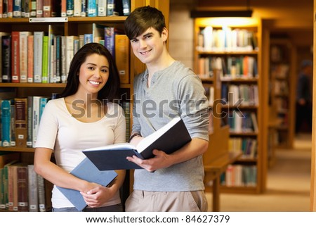 Young students with a book in the library
