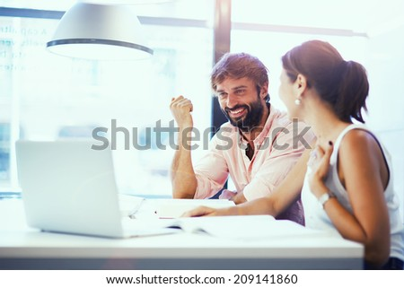 Young students working with laptop in library, couple of young guys studying in university library,international students at exam preparation working with computer, couple of beautiful friends smiling - stock photo