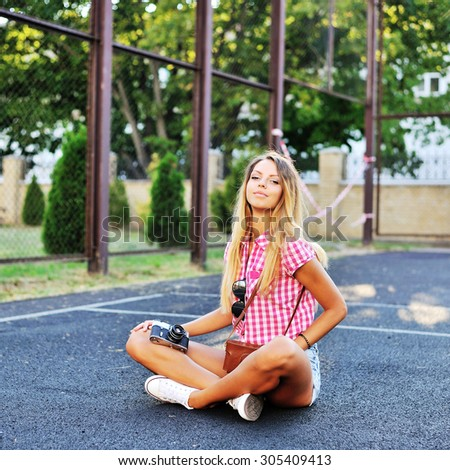 Young stylish girl in casual clothes posing outdoor