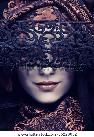 Young stylish lady in black and red silk with creative make-up. - stock photo