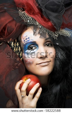 Young stylish lady with red apple