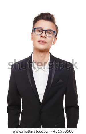 Young stylish man isolated at white. Portrait of confident guy looking at camera. Boy style, trendy male person in eyeglasses and black suit. Modern businessman. - stock photo