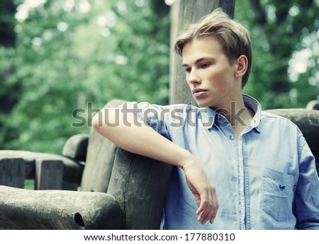 Young stylish man portrait in summer park. Outdoor. - stock photo