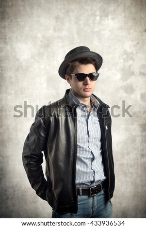 Young stylish man with hat and sunglasses