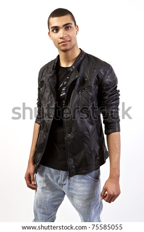 Young stylish mulatto in a leather jacket.