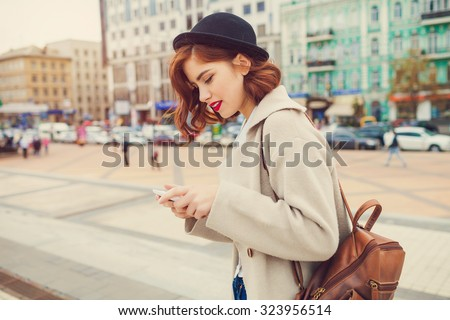 young stylish pretty woman with hat posing in the city streets. vacation europe