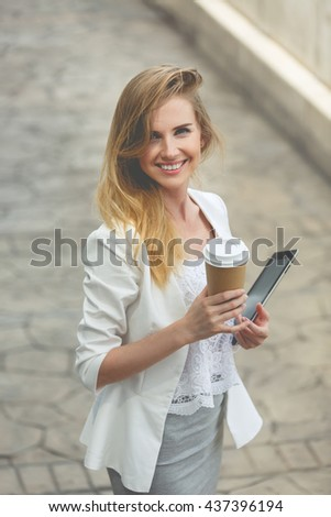 Young stylish woman drinking coffee