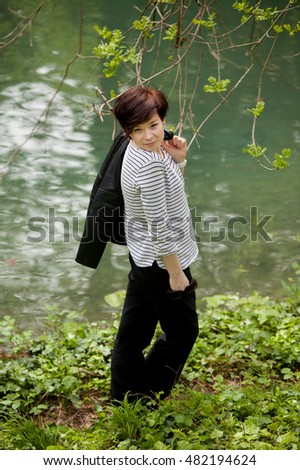 Young stylish woman in the park