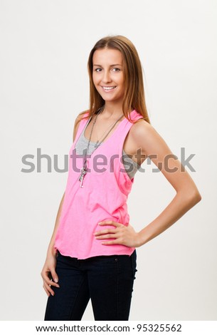 Young stylish woman, smiling. Isolated gray background.