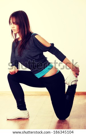 Young stylish woman training modern dance