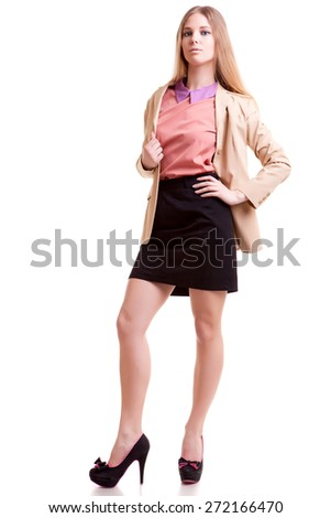 Young succesful and beautiful businesswoman isolated over white background. Studio shooting - stock photo