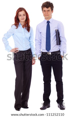 Young successful attractive smiling business couple in blue shirts, isolated on white - stock photo