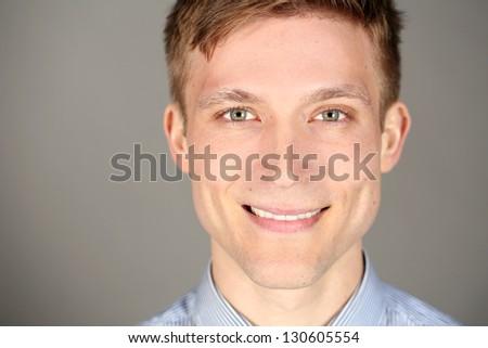 Young successful business man closeup - stock photo