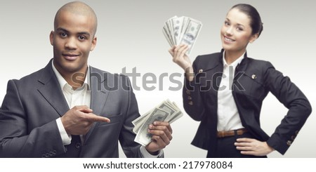 young successful business people standing over gray background - stock photo