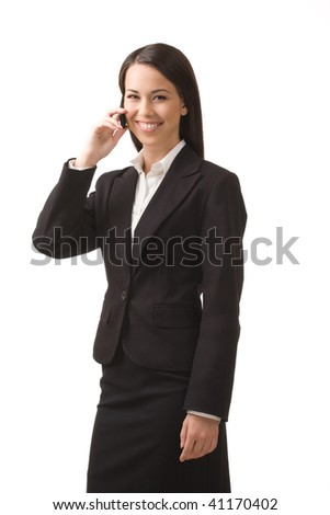 Young, successful business woman with a cell phone isolated on a white background.