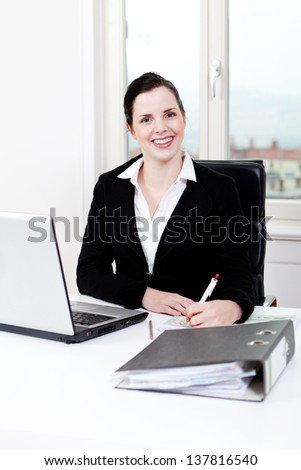 young successful business woman working on computer in office