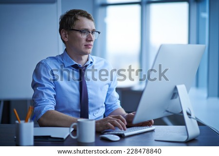 Young successful businessman networking in office - stock photo