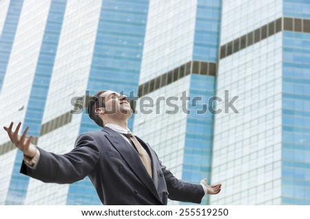 young successful businessman with urban background,modern blur building background. - stock photo