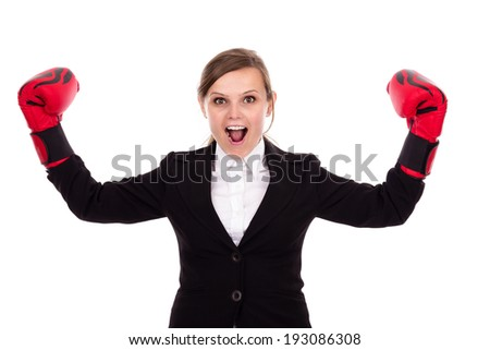 Young successful businesswoman celebrating wearing boxing gloves  isolated over white background - stock photo