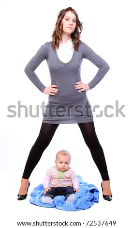 Young successful businesswoman with here little baby. Feminist metaphor. - stock photo