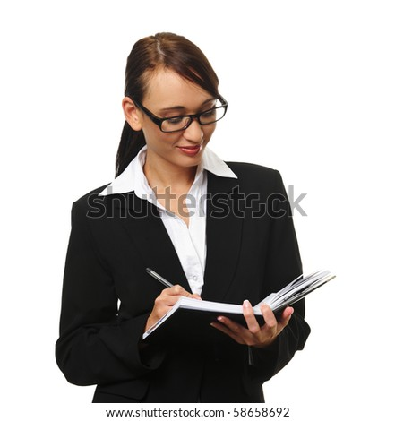Young successful career woman writes in her personal organizer