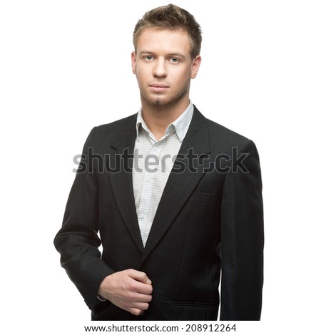 young successful caucasian businessman in black suit standing isolated on white