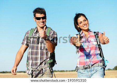 Young successful couple on summer hiking vacation in Castilla y Leon countryside, Spain. Positive man and woman on adventure backpacking travel.