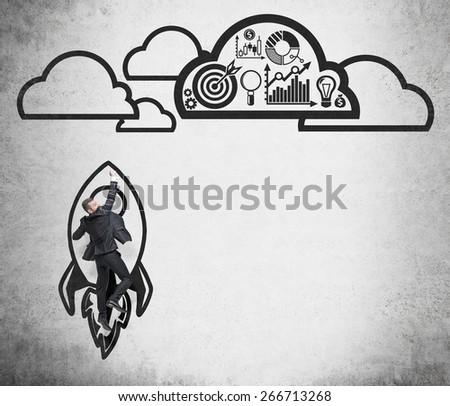 Young successful man is flying to the space on the drawn rocket - stock photo