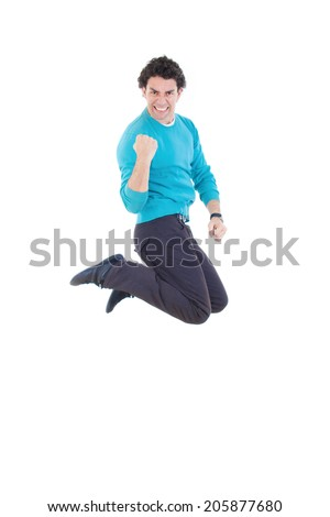 Young successful man jumping out of joy expressing happiness with clenched fist showing sign of success - stock photo