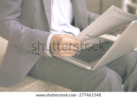 Young successful young man holding a newspaper