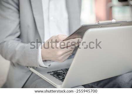 Young successful young man holding a report. Accounting - stock photo
